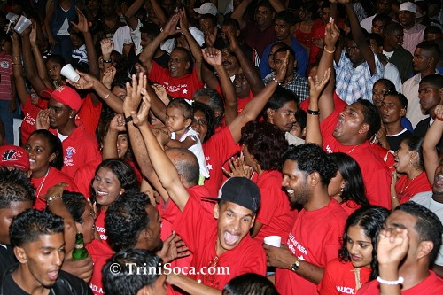 Malick All Stars supporters in red enjoy the Malick All Stars Tassa Group