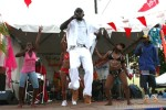 Cleave 'Zion Child' Joseph performing on stage with his carnival section 'Colours'